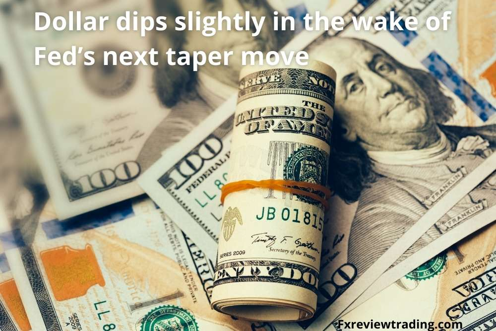 Dollar dips slightly in the wake of Fed's next taper move